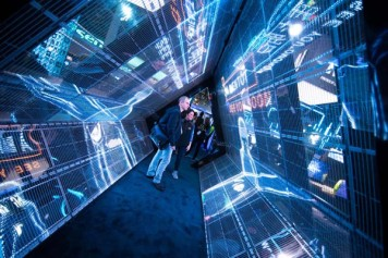 At Intel's 2018 CES booth, visitors step inside an immersive LED tunnel that brings 5G to life. A vistor's presence triggers a three-act interactive story, including safe connected cars that instantly communicate hazards to nearby vehicles and the cloud; smart cities that leverage 5G-connected IoT solutions to quickly defuse potentially dangerous situations; and the power of latency-free virtual reality that will transform education. Intel Corporation displays how the power of data is affecting our daily lives at the 2018 Consumer Electronics Show (CES) from Jan. 8-12 in Las Vegas. (Credit: Intel Corporation)