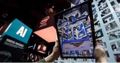 Augmented reality tablets immerse visitors to Intel's 2018 CES booth in an artificial intelligence-powered journey that represents the vast mountains of data housed and scanned by AI in the cloud. One use case shows conservation work using drones to track whales and capture streaming images that are sent back to a boat where AI is used to categorize the data and track the whales' health. Intel Corporation displays how the power of data is affecting our daily lives at the 2018 Consumer Electronics Show (CES) from Jan. 8-12 in Las Vegas. (Credit: Intel Corporation)
